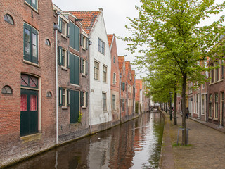 Traditional dutch buildings on canal in Alkmaar