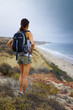 Athletic Woman Hiking Ocean Scenery