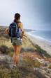 Athletic Woman Hiking Ocean Scenery