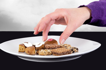 Hand reaching for cake plate