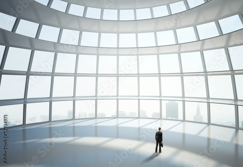 man standing in big hall