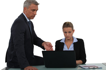 Boss sat with young employee