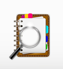 notepad with magnifying glass for you design