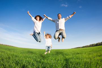 Happy family jumping