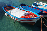 Wooden fishing boats on crystalline water
