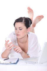 Reclining Woman with computer and phone