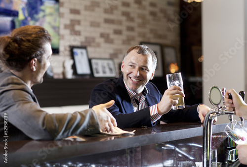 Two friends drinking beer in a bar