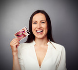 Fototapety woman holding picture with dirty yellow teeth
