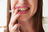 woman with yellow dirty teeth
