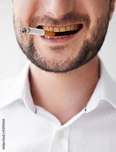 smoking man with dirty yellow teeth