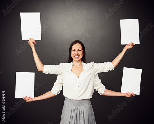 woman with four hands holding white boards