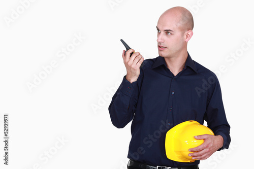 foreman with talkie walkie