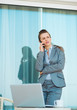 Concerned business woman talking mobile phone on terrace