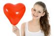 Freundlicher Teenager mit Herzballon
