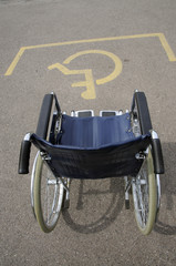 Wheelchair disabled parking place and sign