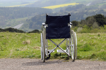 Empty self propel dma wheelchair overlooking english countryside