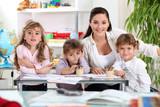 three primary schoolgirls and a teacher