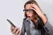 Businesswoman reading message on smartphone