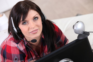 a woman communicating through a webcam
