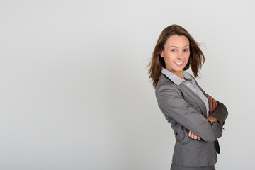 Beautiful businesswoman standing on white background