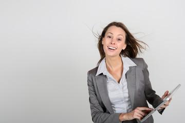 Smiling businesswoman using digital tablet