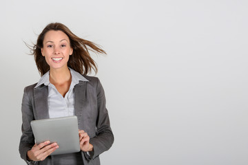Smiling businesswoman using digital tablet