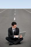 Businessman sat on road