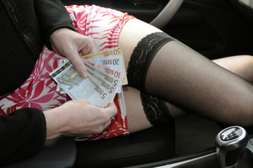 Woman in short skirt counting euros