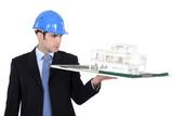 Man holding model housing