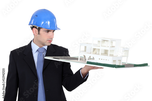 Man holding model housing