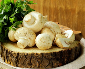fresh mushrooms (champignons) on a wooden table