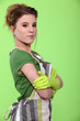 Portrait of a housewife wearing rubber gloves and an apron