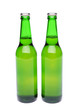 Two bottles of light ale on white background.