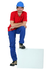 craftsman leaning his foot on a blank box