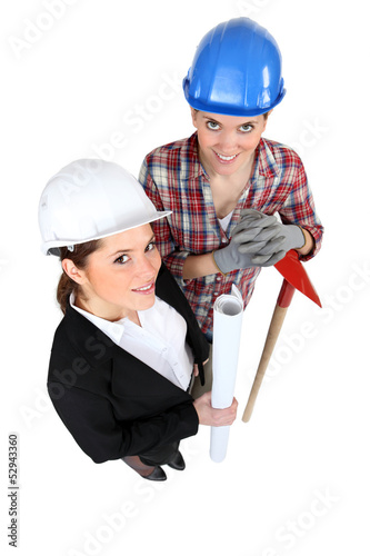 high angle shot of female architect and female bricklayer