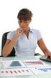 A businesswoman checking prognostic charts.