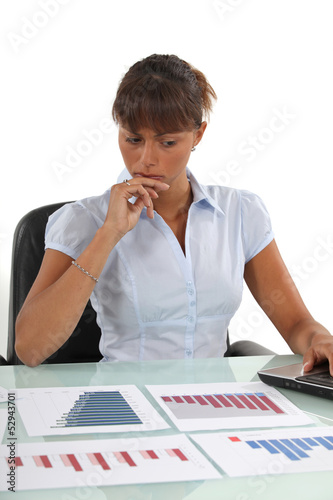 A businesswoman checking prognostic charts.