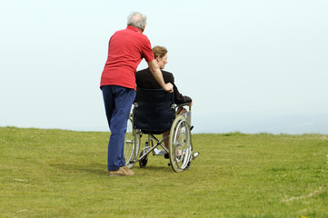 Carer pushing woman in a wheelchair