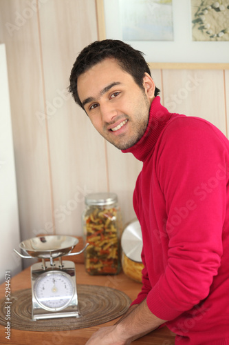 young man in a kitchen