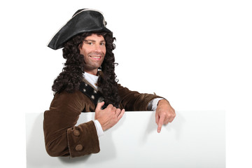 Man in a period highwayman costume