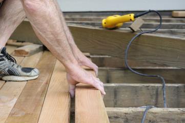 Worker Installing Cedar Deck