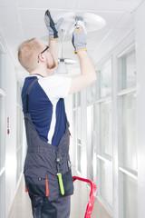 Man Repairing Broken Light