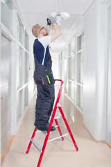 Janitor Fixing Broken Lamp