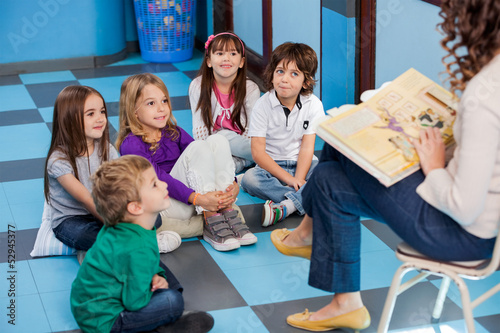 Teacher Reading Story Book To Children