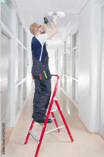 Janitor Fixing Broken Lamp