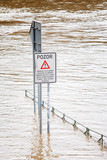 Flood in Prague in 2013. Traffic sign on riverside in water.