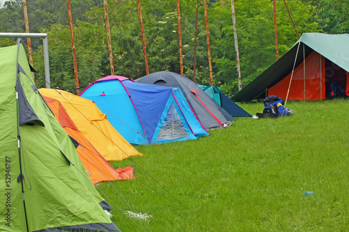 camp with igloo tents scout campers in a green meadow
