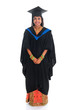 Full body happy Indian university student in graduation gown