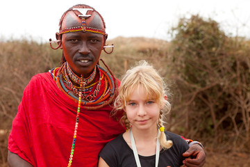 AFRICA, KENYA, MASAI MARA - JULY 2: Male tribal member wearing t