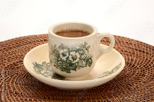A Cup Of Freshly Brewed Coffee On A Table Mat